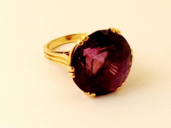 9:  An amethyst set dress ring, the circular, mixed cut