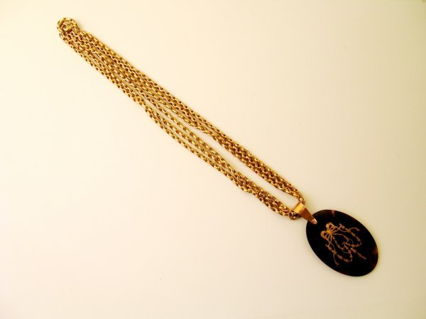 10:  A yellow metal muff/guard chain, the bolt ring cla