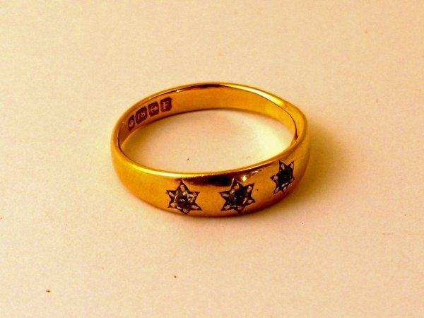 14:  A three stone diamond ring, the three old cut diam