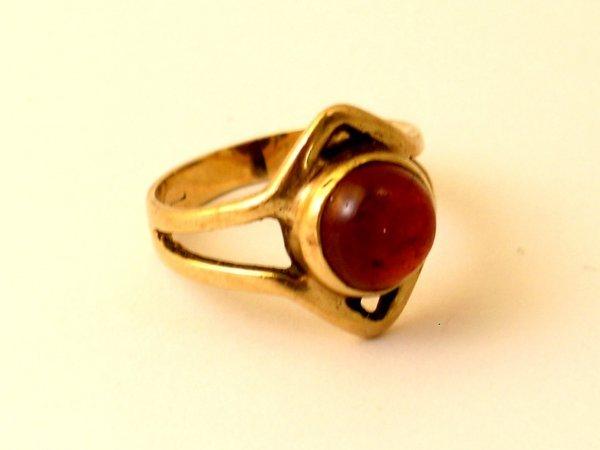 15:  A garnet set ring, the circular cabochon garnet wi