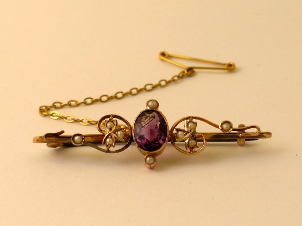 20:  An amethyst and split seed pearl set brooch, the c