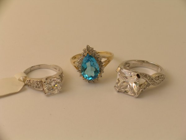 22: A selection of three dress rings to include; a pear