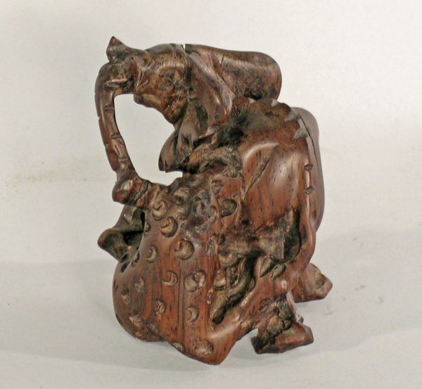 1D: A rosewood group of an elephant and leopard fightin