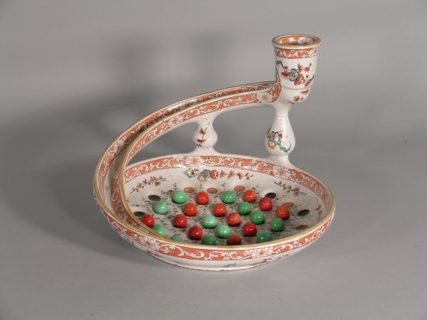 10D: A faience marbles game, 19th century, designed as