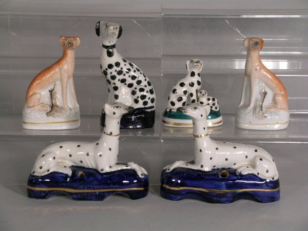 17D: A pair of Staffordshire dalmation pen stands, each