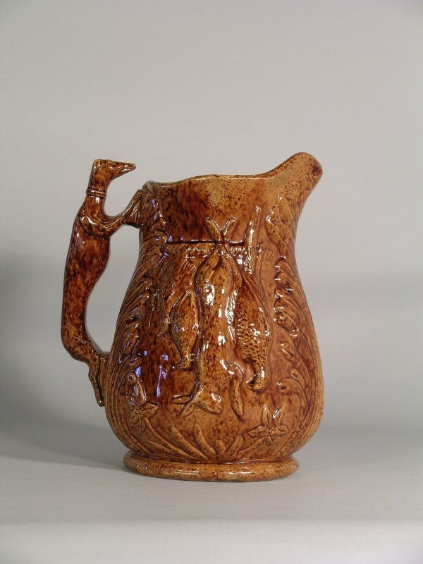 20D: A Staffordshire jug, the stoneware body relief mou