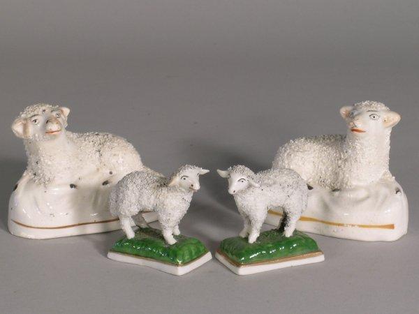 25D: A pair of porcelain sheep, each naturalistically m
