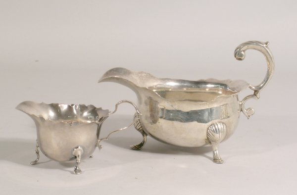 9B: A silver sauce boat, London 1749, of squat baluster