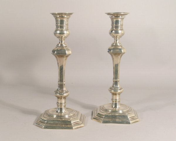 11B: A near pair of 18th century style candlesticks, by