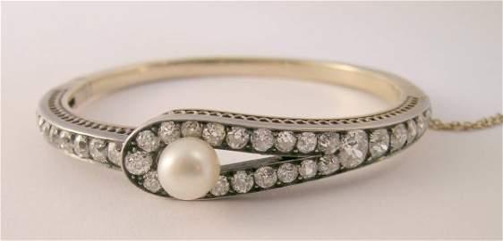 157B: A diamond and untested pearl set hinged bangle, c
