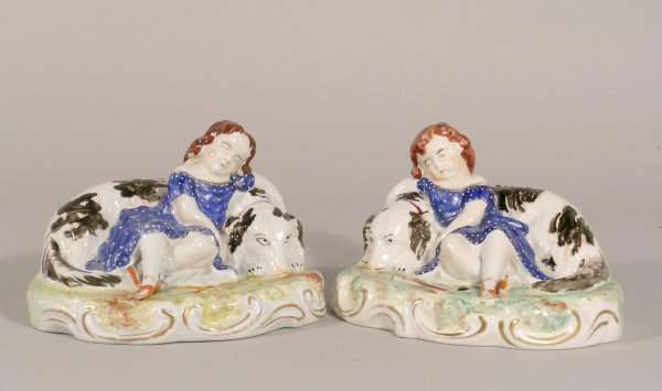 21D: A near pair of Staffordshire figures of recumbent