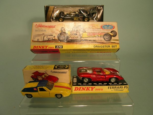 4E: A group of three Dinky Toys fitted with Speed Wheel