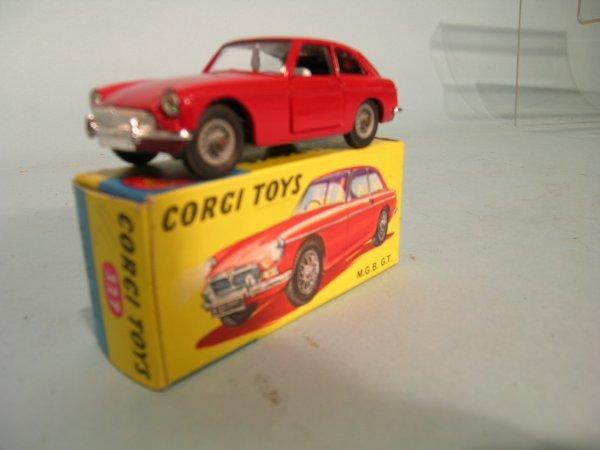 7E: A boxed Corgi Toys no. 327 MGB GT in blue and yello