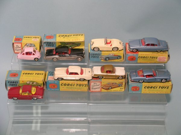 19E: A group of eight 1960s boxed Corgi Toy saloons, to