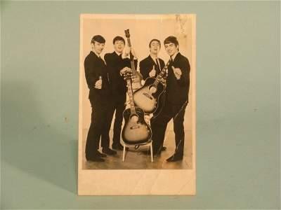 81E: A signed photograph of the Beatles circa 1963, the