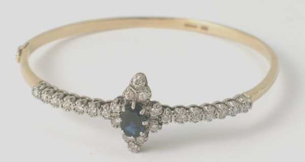 4B: A diamond and sapphire set 9ct gold hinged bangle,