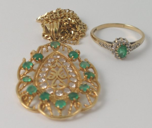 5B: An emerald and white stone set pendant, designed in