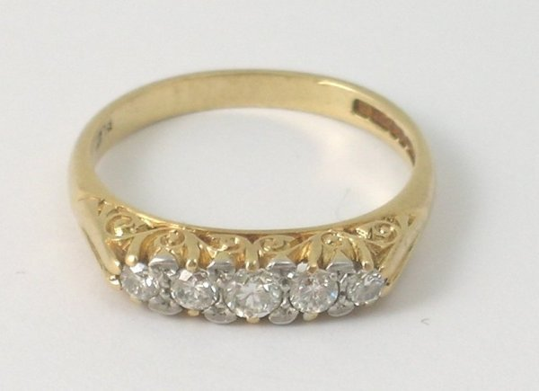 7B: A five stone diamond ring in Victorian style, the f