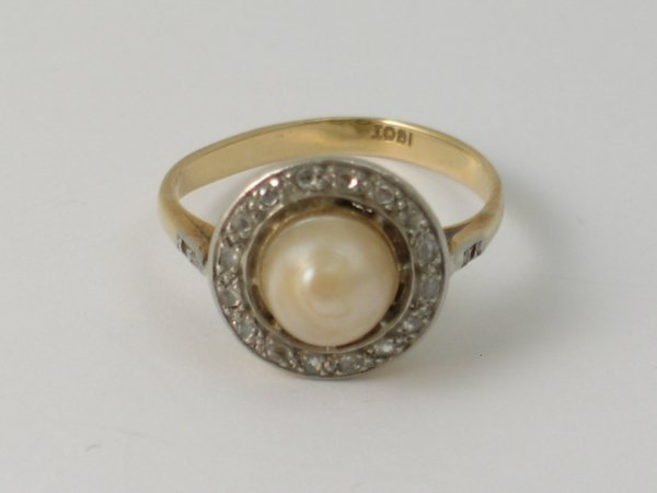 9B: An untested pearl and diamond Art Deco ring, the ce