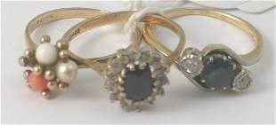 A sapphire and diamond three stone cross over ring