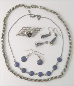 A pair of white metal drop earrings designed as be
