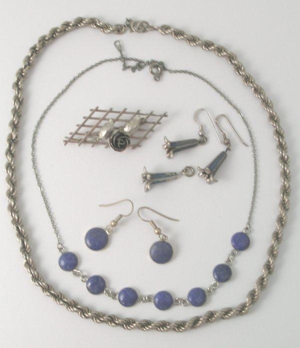 13B: A pair of white metal drop earrings designed as be