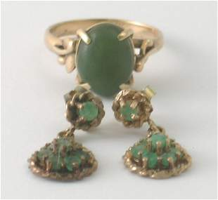 A jadeite set ring, the oval cabochon stone claw s