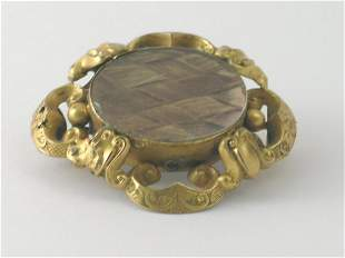 A Victorian mourning brooch, the central oval pane