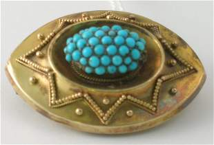 A turquoise set brooch, the navette shaped brooch