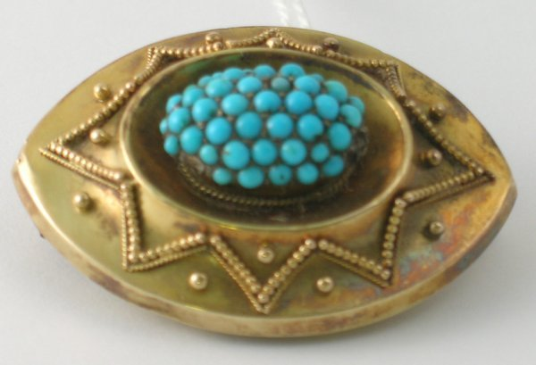 16B: A turquoise set brooch, the navette shaped brooch