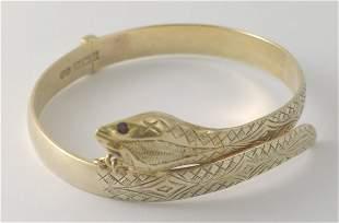 A yellow metal silver hinged bangle, Birmingham 19