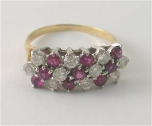 A ruby and diamond dress ring, designed as seven d