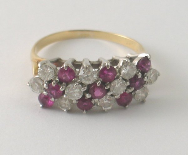 20B: A ruby and diamond dress ring, designed as seven d