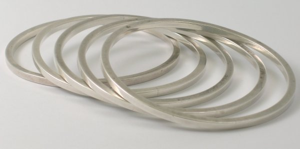 32B: A group of five graduated silver bangles London 19