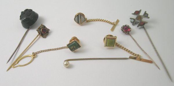 34B: A selection of stick pins to include; a Scottish p