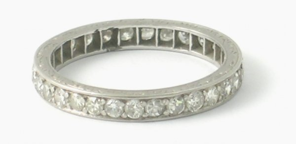 37B: A diamond set full eternity ring, all set in white