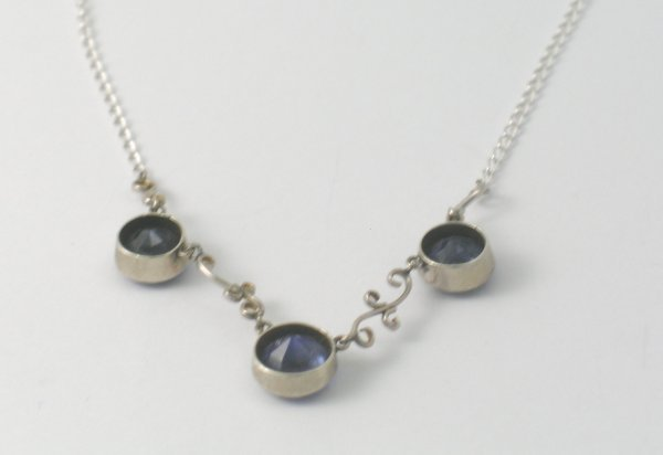 41B: A synthetic sapphire set necklace, the three sapph