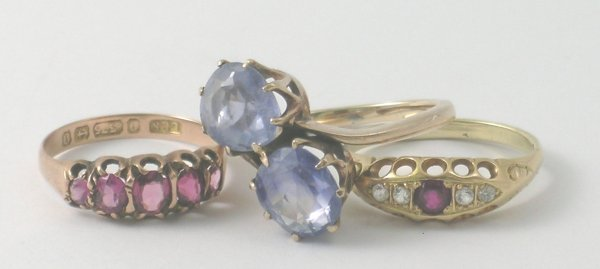42B: Three rings to include; a two stone sapphire ring,
