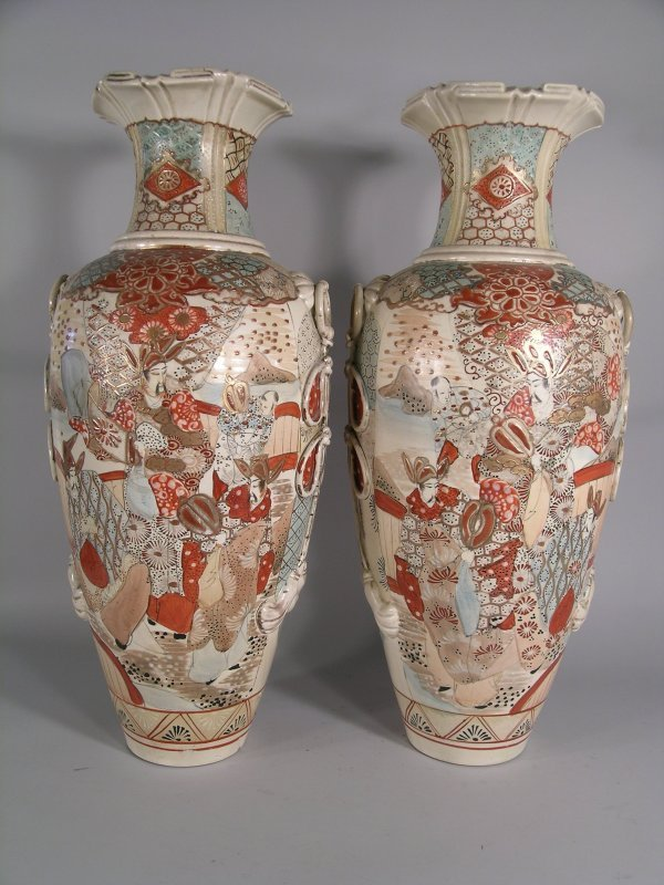9C: A pair of Japanese Kutani earthenware ovoid vases,