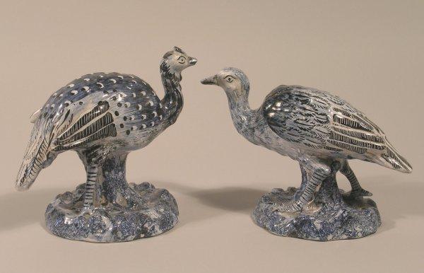 24C: A near pair of French or Dutch tin glazed, earthen