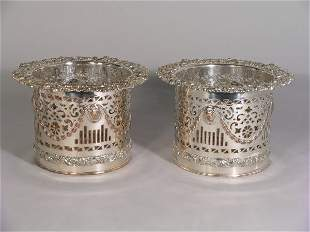 A pair of silver plated bottle coasters, 19th centu