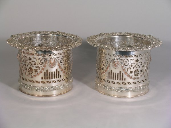 2B: A pair of silver plated bottle coasters, 19th centu