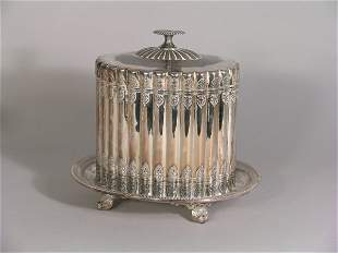 A silver plated biscuit box and stand, of oval lobe