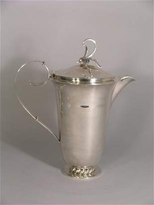 A continental jug and cover of apparent Danish insp