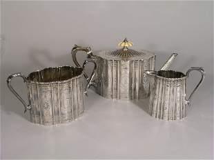A Victorian silver three piece tea service, William