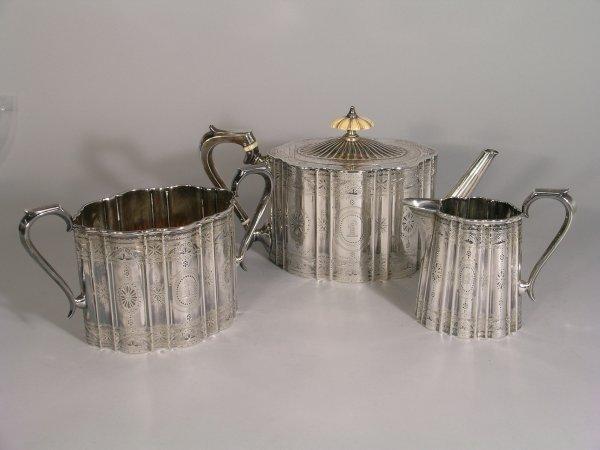 8B: A Victorian silver three piece tea service, William