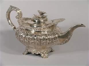 A George IV silver teapot, James Fray, Dublin 1827,