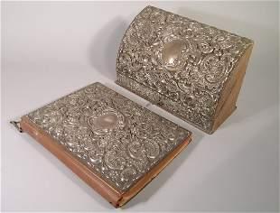 A silver and crocodile skin mounted stationary box