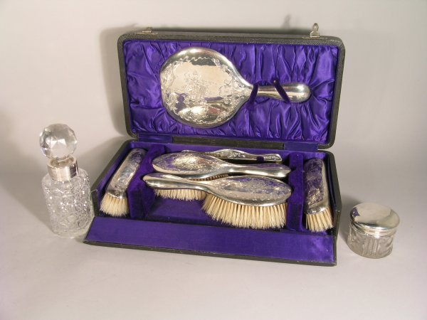 20B: A cased silver backed dressing table set, Williams
