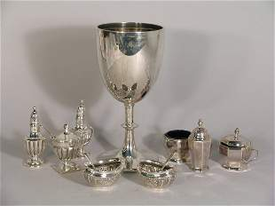 A selection of silver to include; a silver goblet,